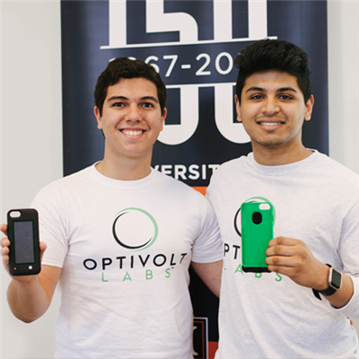 Couston and Kalyanpur showcase the prototype of their phone cases. <em>Photo by Emma Fleener.</em>