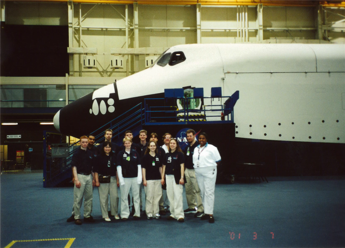 Students pose in front of a space shuttle in Texas.