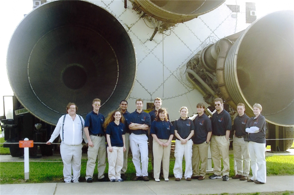 The Float'n Illini pose for a picture in front of a space shuttle at the Lyndon B. Johnson Space Center.