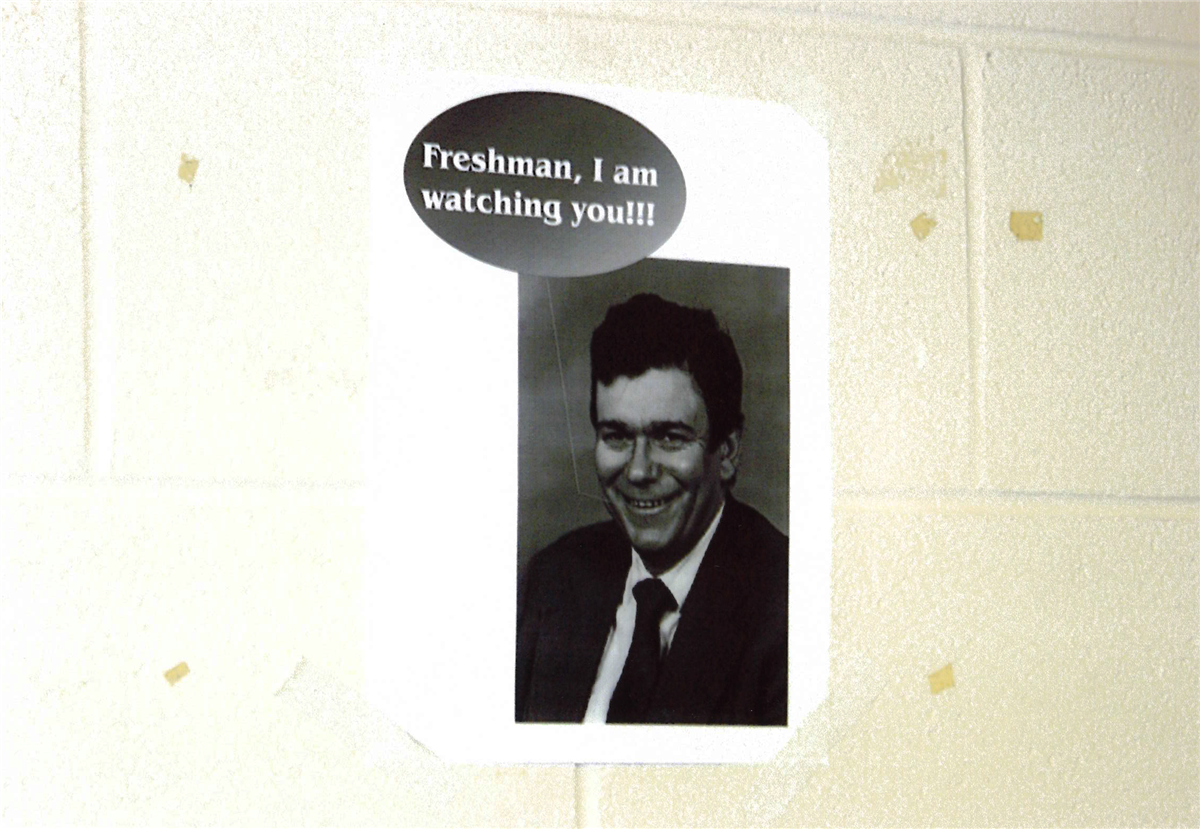 Poster of Professor Reis on the wall captioned 'Freshman, I am watching you!!!'