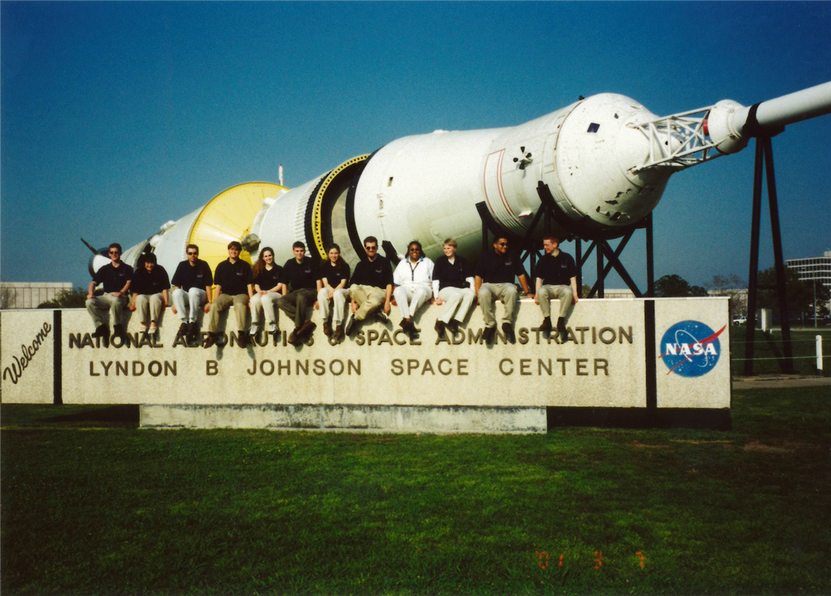 The Float'n Illini sit on a sign reading 'Welcome National Aeronautics and Space Administration Lyndon B. Johnson Space Center NASA'