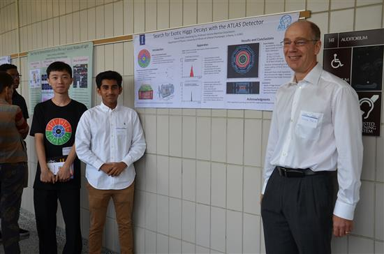 Physics Professor and Young Scholars Program Co-Director Doug Beck poses with Young Scholar Shavon Patel and his mentor Huacheng Cai at the poster symposium at Loomis Lab on July 28, 2017. Patel worked on particle physics in Asst. Professor Verena Martinez Outschoorn's research group.
