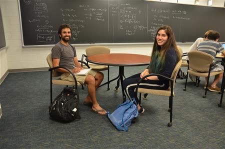 Mentor Will Wheeler meets with Young Scholar Luciana Toledo-Lopez at the Institute for Condensed Matter Theory. Toledo-Lopez worked on topological solid simulation, learning computer coding.