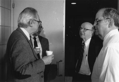 L-R: Charles Slichter, David McCall, and William Slichter (Charles' brother) converse at meeting, undated. Department of Physics, University of Illinois at Urbana-Champaign, courtesy of Emilio Segrè Visual Archives of the American Institute of Physics