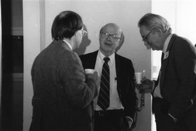 L-R: Unknown, David McCall and Charles Slichter converse, undated. Department of Physics, University of Illinois at Urbana-Champaign, courtesy of Emilio Segrè Visual Archives of the American Institute of Physics