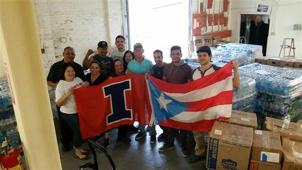 Members of the campus chapter of Puerto Rico Rises deliver emergency supplies to the Aurora chapter, for transport to Florida, and on to Puerto Rico. Luis Miguel de Jesús Astacio is on the far right.