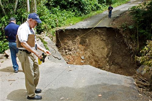 A FEMA team inspects road damage caused by Hurricane Maria, in Puerto Rico.