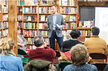 "Matt Eisenbrandt speaks at a book signing in Chicago for his book, ""Assassination of a Saint."" (Image courtesy of Matt Eisenbrandt.)"