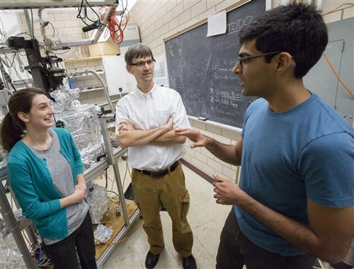 U of I Professor of Physics Peter Abbamonte (center) works with graduate students Anshul Kogar (right) and Mindy Rak (left) in his laboratory at the Frederick Seitz Materials Research Laboratory. Photo by L. Brian Stauffer, University of Illinois at Urbana-Champaign