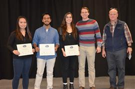 'Bicycle Street Notification System' received the Area Award for Transportation. Team members are Anant Jani, Savannah Russell, and Stephanie Wong. Also pictured are TA Channing Philbrick and Professor Reinhard.