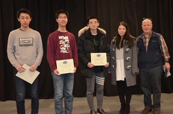 'Low Cost Solution of Thermal Cycler for LifeFoundry, Inc.,' was presented the Area Award for Interdisciplinary Work. The team includes Pei Liu, Shaoyu Meng, and Yuanjiu Hu, who are pictured with TA Xinrui Zhu and Professor Reinhard.