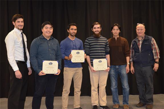 'Assistive Chessboard' won The Michelle and Alex Bratton Senior Design Instructor's Award. The team includes Robert Kaufman, Rushi Patel, and William Sun, who are pictured with TA John Capozzo and Professors Chen and Reinhard.