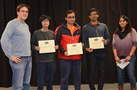 'RC Boat Power and Signal Level Indicator' won the Recreation and Entertainment Area Award. The team includes Sanchit Anand, Sho Harisawa, and Vaibhav Mittal. Professor Oelze and TA Yamuna Phal are also pictured.