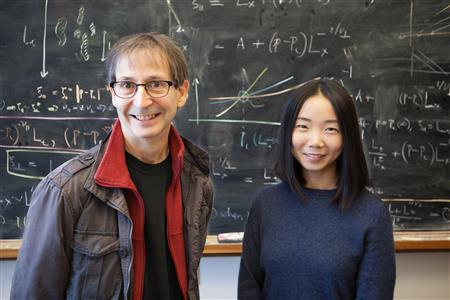 U of I Swanlund Professor of Physics Nigel Goldenfeld (left) works with colleague Chi Xue (right) at the Carl R. Woese Institute for Genomic Biology. Photo credit: University of Illinois at Urbana-Champaign.