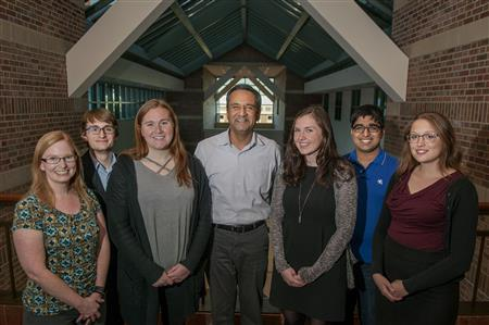 Cancer Scholars director Rohit Bhargava (center) joins program advisor Marcia Pool (far left) and a few of the first cohort of undergraduate students Pierce Hadley, Lauren Sargeant, Madelyn O'Gorman, Sreyesh Satpathy, and Miranda Dawson outside Bhargava's office at Beckman Institute.