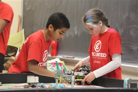 Competitors test their skills at building a robot from LEGO Mindstorms and completing as many tasks in 2:30.