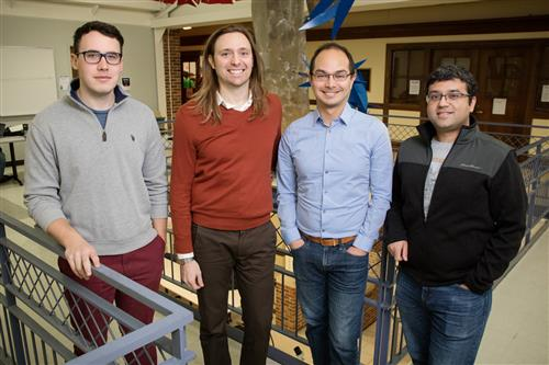 Researchers Kitt Peterson, left, Taylor Hughes, Wladimir Benalcazar and Gaurav Bahl are the first to demonstrate a new phase of matter called quadrupole topological insulators that was recently predicted using theoretical physics.