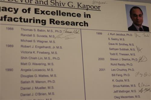 This plaque displays signatures left by graduates of Professor Kapoor and former colleague, the late Professor Richard DeVor.
