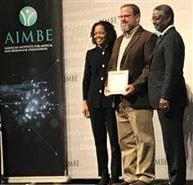 Professor Brad Sutton (center) was inducted as a fellow of the American Institute for Medical and Biological Engineering at the organization's annual meeting in Washington, DC.