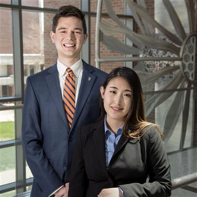 The University of Illinois College of Engineering's first ILEE graduates are Tom Jozefowicz (ISE) and Connie Fan (CS).