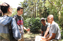 From left: Cara Feng, Ryan Grosso, and David Wilkerson-Lindsey interview Monteverde resident Guillermo Vargas about the diversified farm he runs in cooperation with his extended family in Costa Rica. (Photo by Edmond Fitzgerald.)