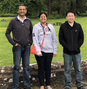 Illinois Founder Professor Rohit Bhargava (left) and Bioengineering graduate students Shachi Mittal (center) and Kevin Yeh have developed a novel imaging method (an infra-red microscope and artificial intelligence algorithms) that simultaneously sub-types cancer cells and the tumor microenvironment. They presented this technology and results at the International Society of Clinical Spectroscopy SPEC 2018 conference in Glasgow in June.