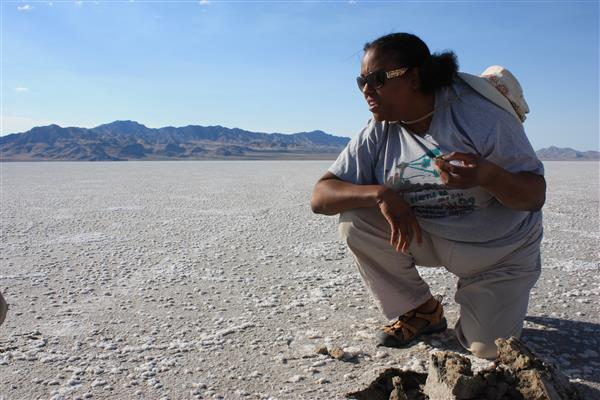 Lynch examining microbial mats in the Pilot Valley Basin, a paleolake basin in Utah. Photo by NASA Astrobiology Institute.