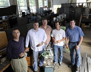 The Illinois Physics ATLAS team is photographed in Physics Lab 1 in Urbana for an article in <em>The News-Gazette</em> in September 2008. Pictured are (L-R) Professor Tony Liss, Professor Mark Neubauer, high-energy physics technician Dave Forshier, Professor Steve Errede and graduate student James Coggeshall. Photo by John Dixon/The News-Gazette