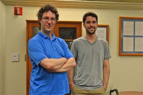 Professor Bryan Clark and graduate student Eli Chertkov pose in the common room of the Institute for Condensed Matter Theory. Photo by Siv Schwink, Department of Physics, University of Illinois at Urbana-Champaign