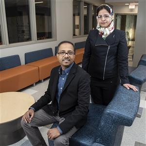 Bioengineering Associate Professor Dipanjan Pan (seated) and doctoral student Fatemeh Ostadhossein have demonstrated a drug-free, nanotechnology-based method for detecting and destroying the bacteria that causes dental plaque.