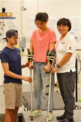 Graduate student Chenzhang Xiao, left, and Professor Elizabeth Hsiao-Wecksler, right, demonstrate their energy-harvesting mechanism within the crutch.