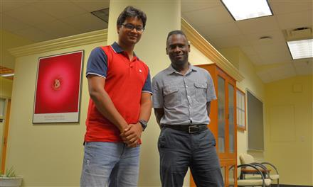 University of Illinois at Urbana-Champaign Professor of Physics Philip Phillips (right) and graduate student Bikash Padhi pose in the Institute for Condensed Matter Theory on the Urbana campus. Credit: Siv Schwink, University of Illinois at Urbana-Champaign