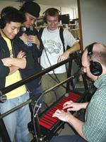 Mark Smart plays the Continuum Fingerboard with students.