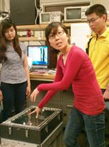Sabrina Cheng (left), Sze Yin Foo, and Hoong Chin Ng demonstrate their Otter Print Shooter device.