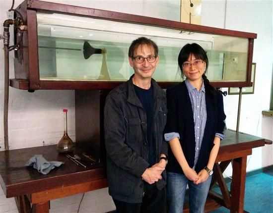 Nigel Goldenfeld and Hong-Yan Shih in front of the apparatus used by Osborne Reynolds in 1883 to conduct the first scientific studies of the laminar-turbulent transition in pipe flow. Reynolds' apparatus is on display at The University of Manchester, School of Mechanical, Aerospace and Civil Engineering, UK.