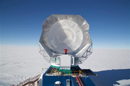 U of I astronomy graduate student Andrew Nadolski stands in front of the South Pole Telescope in Antarctica. Nadolski was stationed at the South Pole for the first year after installation of the third generation camera on the telescope.