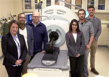 Members of the research team are pictured in the Molecular Imaging Lab at the Beckman Institute: from left, Iwona T. Dobrucka, Dipanjan Pan, Wawrzyniec Dobrucki, Jamila Hedhli, Aaron Schwartz-Duval, and Christian J. Konopka.