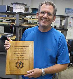 Dan Mast, Manager of Systems and Services in ECE, received a recognition from AMD for his 13 years of work on the Jerry Sanders Design Competition that is held annually during Engineering Open House.