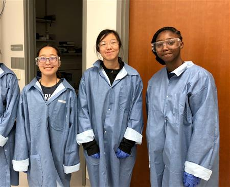 Participants in the 2018 Girls Learning Electrical Engineering (GLEE) camp don their lab coats and googles. As part of this study, underrepresented students will receive scholarships to these University Illinois summer camps.