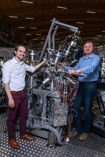 Niels Schröter (left) and Vladimir Strocov at their experimental station in the Swiss Light Source SLS at PSI. Photo credit: Paul Scherrer Institute/Mahir Dzambegovic