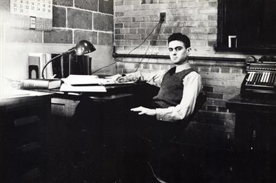 Chester P. Siess at desk