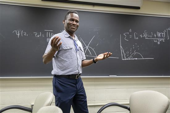 Illinois Physics Professor Philip Phillips presenting to his group at the Institute for Condensed Matter Physics in Urbana. Photo by L. Brian Stauffer, University of Illinois at Urbana-Champaign