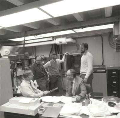 Senior staff reviewing study results, 1980