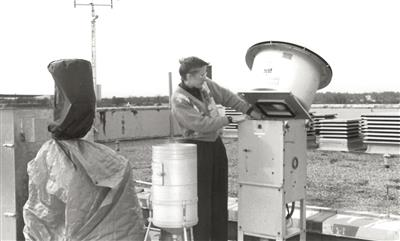 Sue Larson removes filter at air quality sampling site, 1992