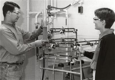 Prof. Lutgarde Raskin discuss wastewater treatment processes with grad student, 1998