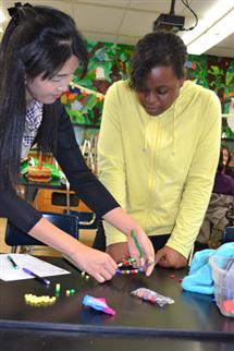 A Jefferson Middle School student learning about molecular and cell biology