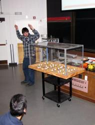 ANS member Robert Geringer gets visitors ready for the mousetraps to spring.