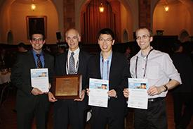 ECE graduate students Josh Wood, Kevin He, and Justin Koepke were honored at the IEEE Nano 2012 Conference. They are pictured with their advisor Professor Joe Lyding (second from left).