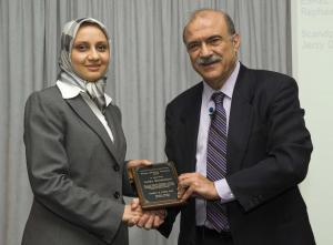 Zahra Mohaghegh, left, receiving the George Apostolakis Fellowship Award from the International Association of Probabilistic Safety Assessment and Management (PSAM).