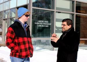 Mike Lively and J.P. Allain outside the Micro and Nanotechnology Laboratory, which houses Allain